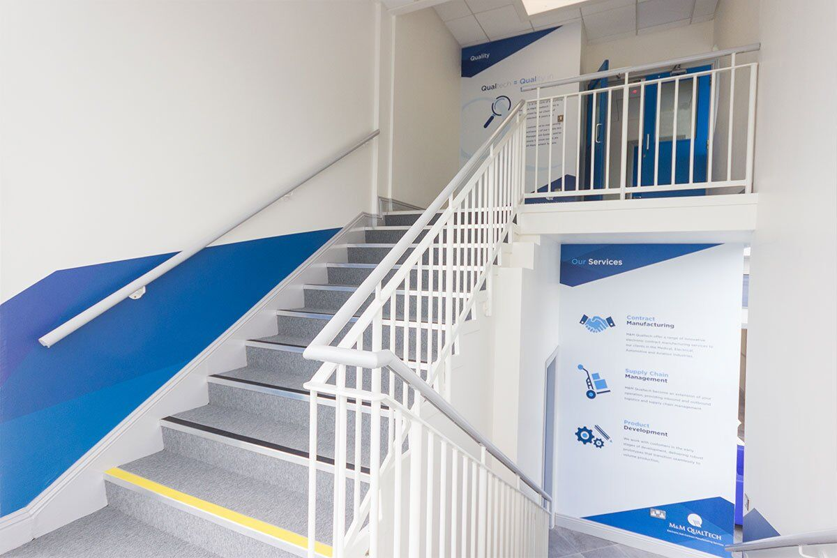 Interior corporate wall branding for M&M Qualtech