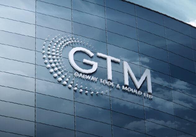 Close up of GTM building logo sculpture