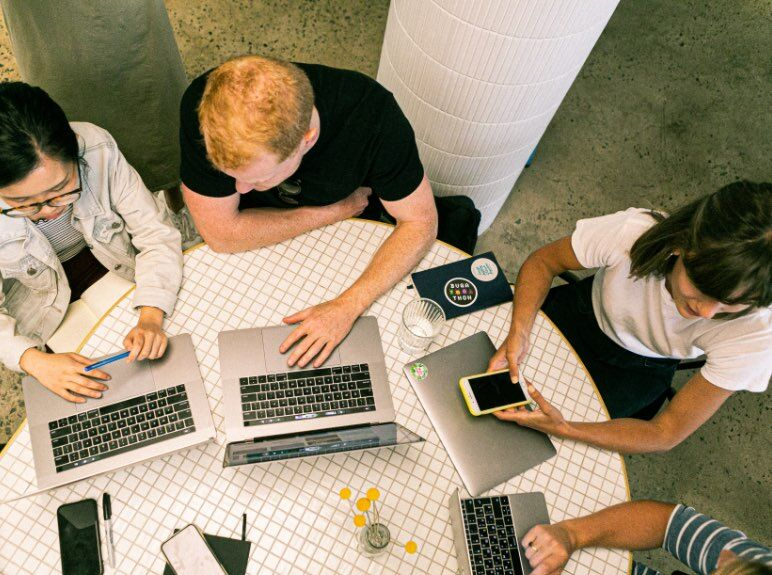 Aerial view of a group of web developers in a meeting