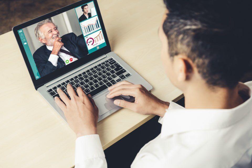 Business Professional attending a virtual presentation
