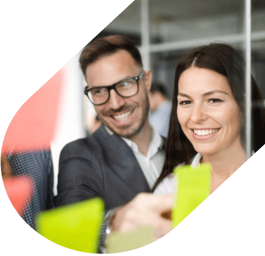 Happy business professionals developing a strategy